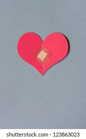 Broken heart combined with a square bandage
