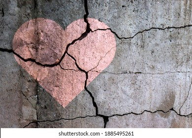 A broken heart. Drawing of a heart on a cracked wall. Broken relationships. Treason and betrayal. Past love. A quarrel.