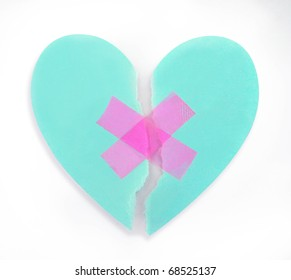 broken heart fixed up with adhesive plaster