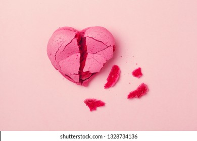 broken heart isolated on pink background, divorce, depression and breakup concept, crying, medical cardiovascular health care problems