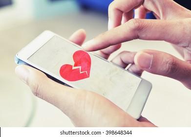 broken heart on smart phone concept background