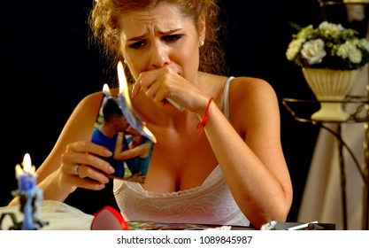 Broken heart woman. Couple break up. Sad bride on unhappy wedding. Woman and groom quarrel. Girl burns in fire candle family pictures. Serious relationship.