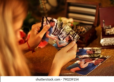 Broken heart woman. Couple break up. Woman and man quarrel. Hasty decision irreparable error. Close up of female hands tearing family pictures.