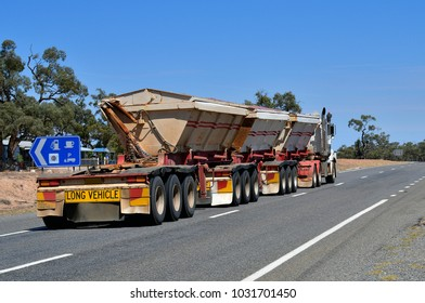 BROKEN HILL, NSW, AUSTRALIA - NOVEMBER 18: Heavy truck with three trailers on Silver City highway at Coombah roadhouse, on November 18, 2017, Broken Hill, Australia