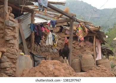 Broken houses in village after cyclone Titli