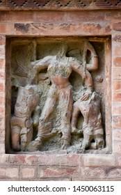 BROKEN IDOL ENGRAVED IN THE ANCIENT BRICK TEMPLE BUILD IN GUPT DYNESTY SITUATED IN BHEETARGAON KANPUR NAGAR UTTAR PRADESH INDIA