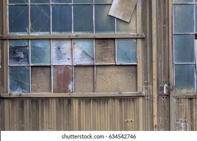 Broken industrial windows wall background