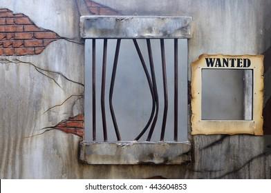 Broken jail with empty placard held