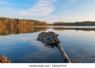 a broken jetty in a lake in the forest
