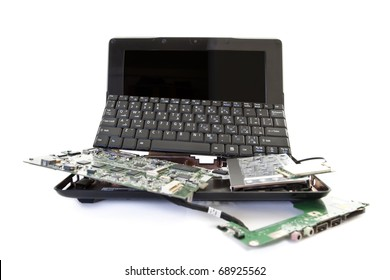 broken laptop disassembled into parts