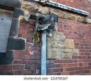 Broken lead drainpipe hopper