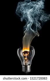 broken light bulb and smoke from a burning spiral on a black background