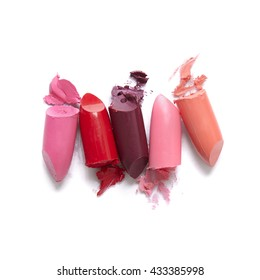 Broken lipstick make up isolated on a white background