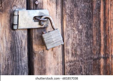 Broken Lock on a Wooden Door