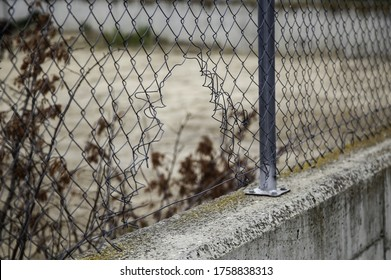 Broken metal protection fence, construction and architecture, security