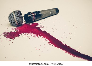 Broken microphone with blood - Threatening press freedom concept