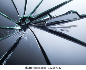 Broken mirror shattered in many pieces.