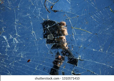 broken mirror. broken mirror with sky and camera reflection. 7 years bad luck.