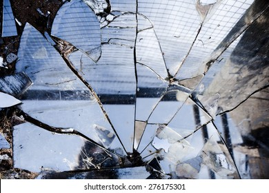 Broken mirrors make a beautiful reflection in the sun, left in the desert amongst trash and found pieces of art and garbage.