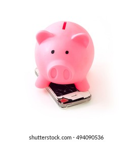Broken mobile phone with pink piggy bank. Concept photo with meaning to keep saving money for buy new smartphone. Selective focus