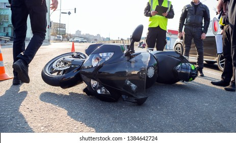 broken motorcycle on the road accident site