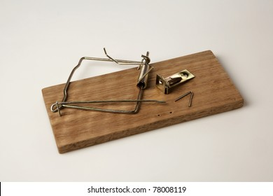 broken  mouse trap on white background