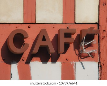 "Broken ""CAFÉ"" neon sign in the street in France."