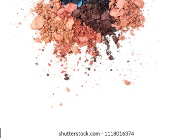 A broken neutral colored eye shadow make up palette isolated on a white background. Top view, flat lay. Copy space for your text