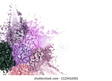 A broken neutral colored eye shadow isolated on a white background. Top view, flat lay. Copy space for your text