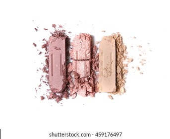 Broken neutral eye shadow make up trio isolated on a white background