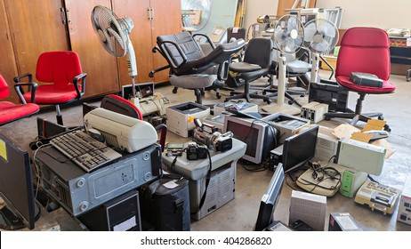 Broken office chairs and electronic waste in the store room