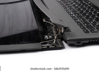 broken old laptop isolated on white background.
