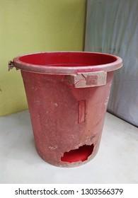 Broken old plastic bucket.
