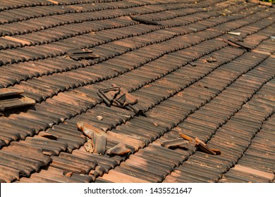 Broken old terracotta tile on a roof, traditional cover in India, GOA. Close up. Summer textured background.