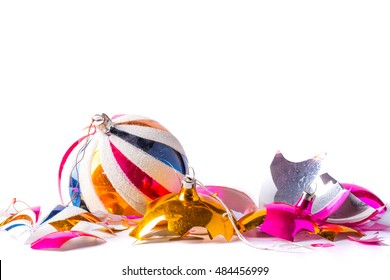 Broken old vintage Christmas ball on white backgroound. Crashed yellow and pink bauble.