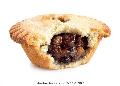 Broken open traditional british christmas mince pie with fruit filling isolated on white.