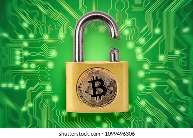 Broken padlock with bitcoin logo. Conceptual picture illustrating crypto currency hacking and theft.