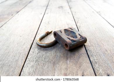 broken padlock on wood