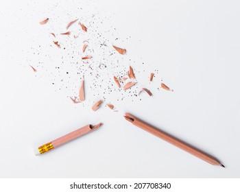 Broken Pencil on white paper