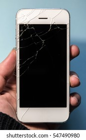Broken phone in a hand, black screen
