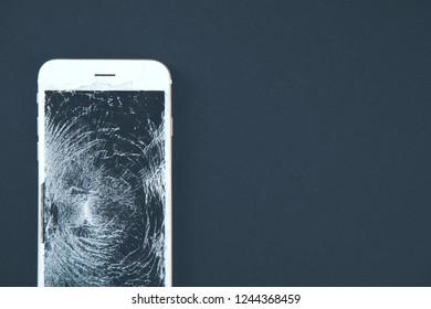 broken phone on black background
