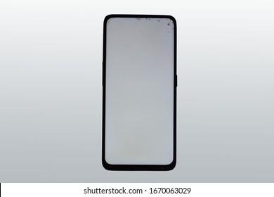 Broken phone on a black background