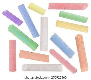 broken pieces of colored chalk isolated on white background