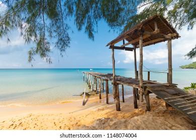 broken pier at sunset beach, turquoise water, Koh Rong Samloem, Sihanoukville, Cambodia