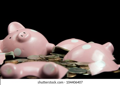 Broken piggy bank with cash & coins