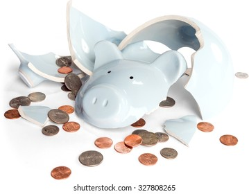 Broken piggy bank with coins scattered