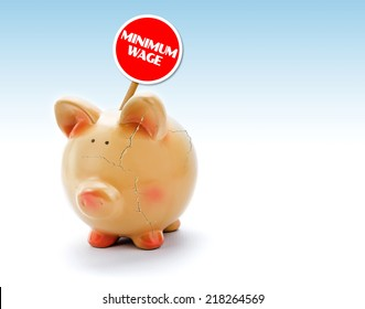 """Broken piggy bank with cracks and """"Minimum Wage"""" tag"""