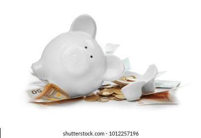 Broken piggy bank with money on white background
