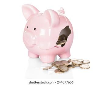 Broken Piggy Bank With Money Over White Background