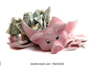 broken piggybank with dollar notes